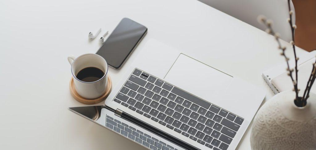 silver-apple-keyboard-beside-white-ceramic-mug-israbell-com