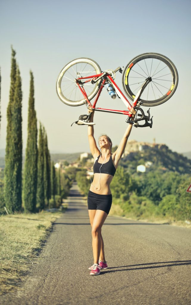 woman-carrying-a-bicycle-israbell-com